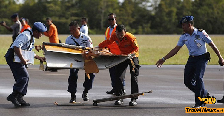 Tail of AirAsia jet from Flight QZ8501 found, divers expect black box to be nearby